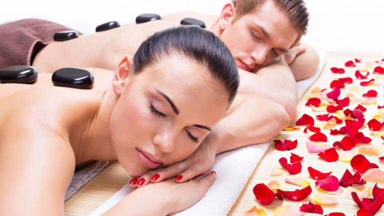 portrait-attractive-couple-relaxing-spa-salon-with-hot-stones-body-min-scaled.jpg